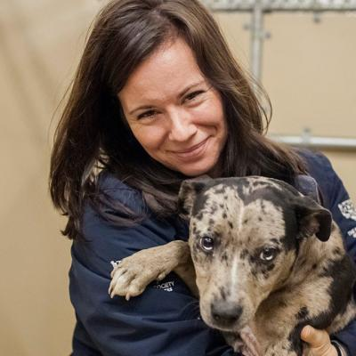 A woman holds a shelter dog