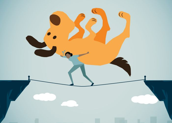 illustration of a woman trying to carry a massive dog across a tightrope