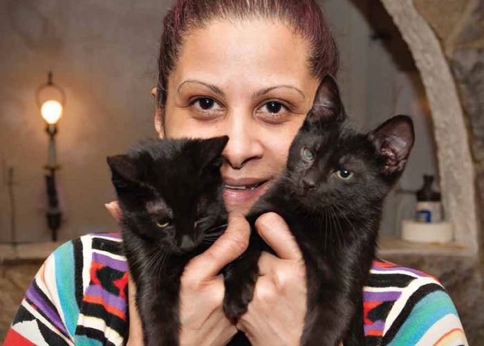 Woman with two black cats